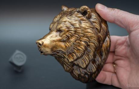 Grizzly, brown bear head polyurethane resin casting. Faux metal painting applied.