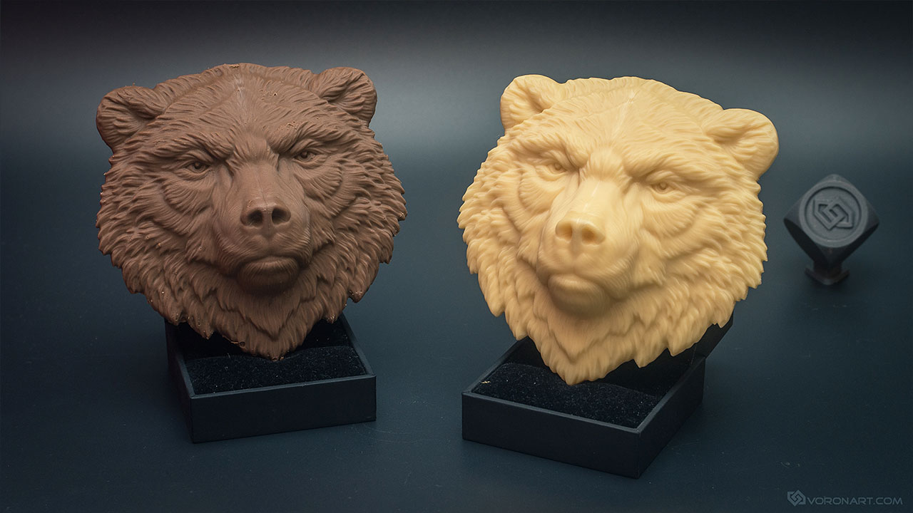Bear face relief model. Cast in chocolate and plastic, 10cm