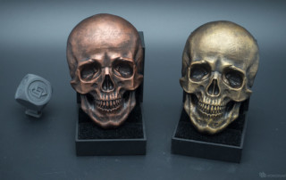 Human skull relief. Faux metal using acrylic paint